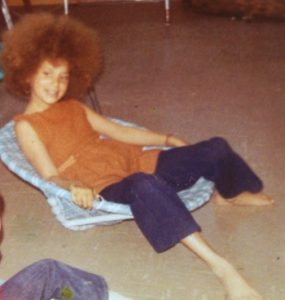 Little hippy Laurie with her big afro